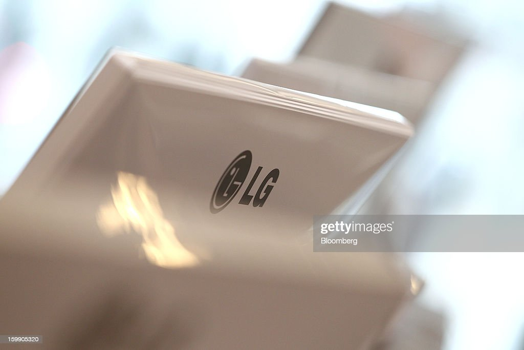 The LG Corp. logo is displayed on the back of a computer screen using LG Display Co. panels at the company's flagship store in Seoul, South Korea, on Tuesday, Jan. 22, 2013. LG Display Co., the world's second-largest maker of flat panels, is scheduled to release fourth-quarter earnings on Jan. 24. Photographer: SeongJoon Cho/Bloomberg via Getty Images