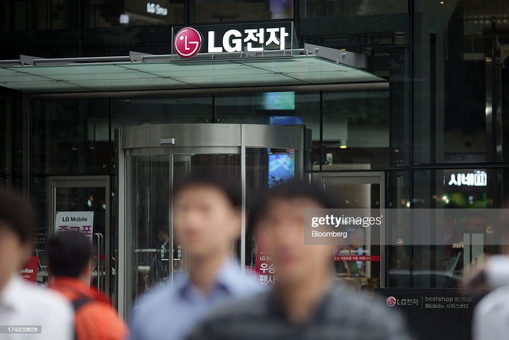 The LG Electronics Inc. signage is displayed outside one of the company's bestshop stores in the Gangnam area of Seoul, South Korea, on Wednesday, July 24, 2013. LG Electronics, the worlds second-largest television maker, posted second-quarter profit that missed analyst estimates on slowing demand for sets and increased spending on marketing for smartphones. Photographer: Woohae Cho/Bloomberg via Getty Images
