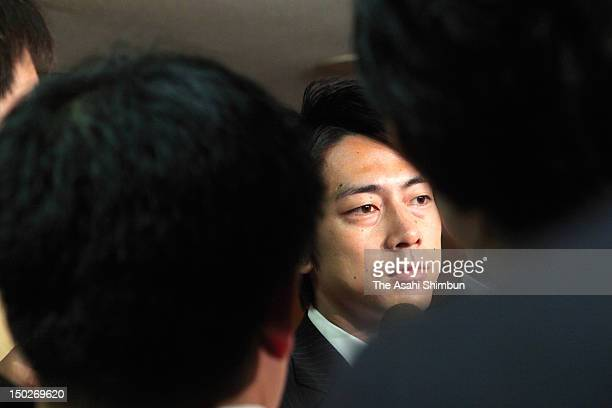 The Liberal Democratic Party lawmaker Shinjiro Koizumi speaks to the reporters after being issued a warning by the party by voting to the...