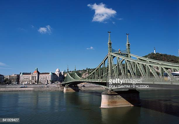 The Liberty bridge with the Gellert Bath and Hotel in the background Budapest Hungary