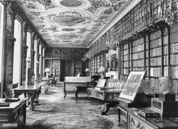 The library of Chatsworth House a large country estate in Derbyshire circa 1930