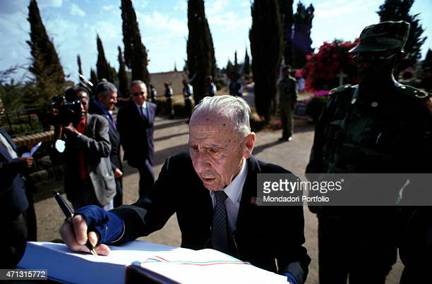 The lieutenant colonel Amedeo Guillet being photo shooted in an Italian cemetery while celebrating his return to Eritrea after 50 years Asmara...