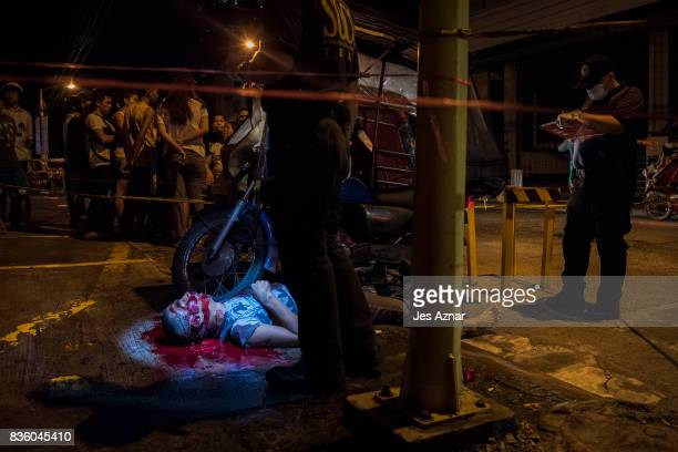 The lifeless body of a man lies on a street on August 19 2017 in Mandaluyong Philippines A recent spike in the killings related to the government's...