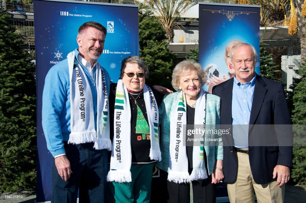 "The Lifeline Program President and CEO Scott Page, Leslie Scott (69) of Coventry, RI, winner of The Lifeline Program's national ""Bucket List"" Facebook contest at the Los Angeles Zoo, The Lifeline Program spokesperson Betty White and L.A. Zoo Director John Lewis attend the 'White Hot' Holiday Event at The Los Angeles Zoo on December 11, 2012 in Los Angeles, California."