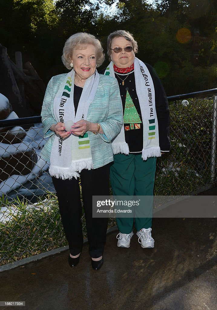 "The Lifeline Program spokesperson Betty White (L) and Leslie Scott (69) of Coventry, RI, winner of The Lifeline Program's national ""Bucket List"" Facebook contest at the Los Angeles Zoo attend the 'White Hot' Holiday Event at The Los Angeles Zoo on December 11, 2012 in Los Angeles, California."