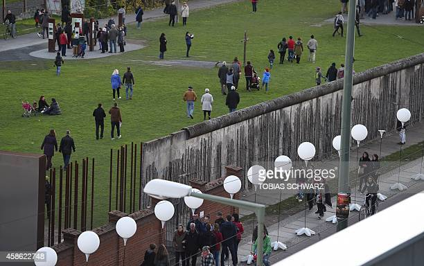 The light installation Lichtgrenze is seen at the former Berlin wall Bernauer street memorial in Berlin on November 8 2014 Germany kicked off...