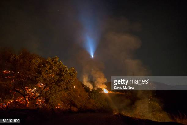 The light of a firefighting helicopter is seen during a night flight over the La Tuna Fire on September 2 2017 near Burbank California Los Angeles...