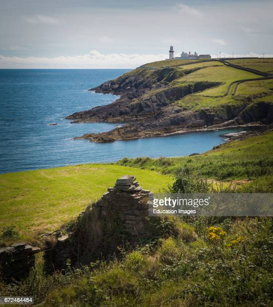 The lighthouse and keepers houses at Galley Head County Cork Republic of Ireland Eire The lighthouse dates from the 1870's Ruins of cottage in...