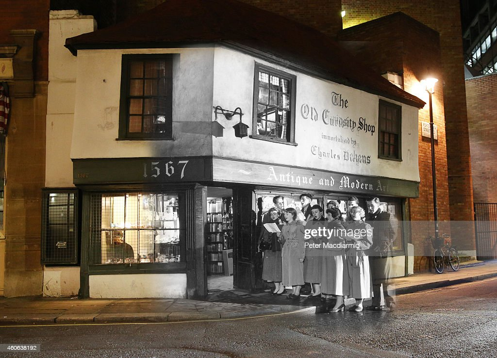 In this digital composite image a comparison has been made of London at Old Curiosity Shop in 1956 (Archive, Topical Press Agency) and Modern Day 2014 (Peter Macdiarmid) at Christmas time. LONDON, ENGLAND - DECEMBER 16: The lights are on inside The Old Curiosity shop on December 16, 2014 in London, England. Christmas is an annual religious feast day originally set on December 25 to celebrate the birth of Jesus Christ and is a cultural festival and public holiday celebrated by billions of people around the world.