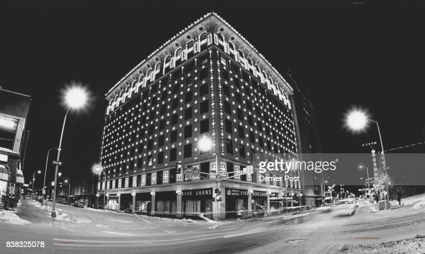 The lights came on tonight for the first time in 12 years at the Insurance Exchange Building on the corner of 15th and Champa Streets in downtown...