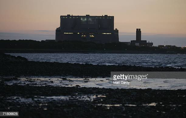The lights of Hinkley Point Nuclear Power Station are seen on July 17 2006 in Somerset England The Prime Minister Tony Blair has called for the...