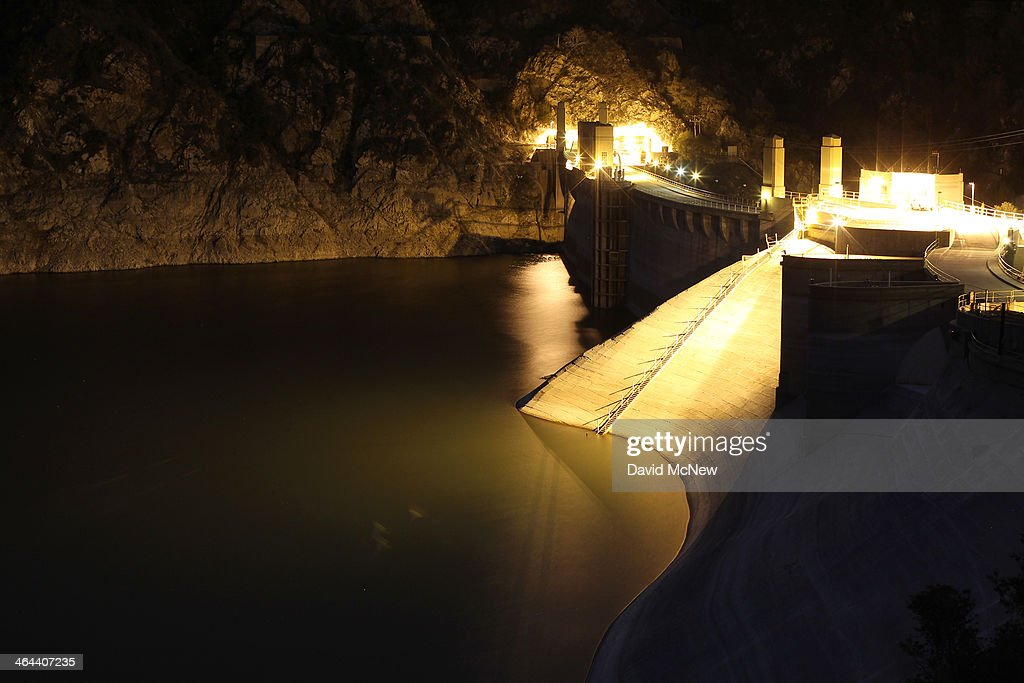 The lights of Morris Dam illuminate the low water level of Morris Reservoir before dawn on the San Gabriel River in the Angeles National Forest on January 22, 2014 in near Azusa, California. Now in its third straight year of drought conditions, California is experiencing its driest year on record, dating back 119 years, and reservoirs throughout the state have low water levels. Unseasonable dangerous wildfire weather helped spread the nearby 1,952-acre Colby Fire which firefighters are about to contain but not before it destroyed five homes, damaged 17 others and injured six people. Gov. Jerry Brown officially declared a drought emergency on Friday to speed up assistance to local governments, streamline water transfers and potentially ease environmental protection requirements for dam releases.