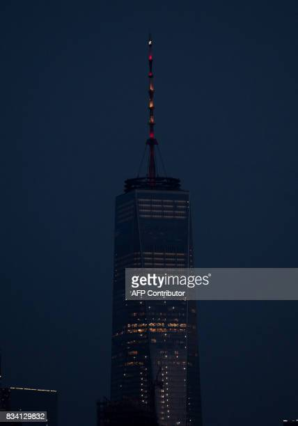 The lights of One World Trade Center are lit in the colors of the Spanish flag to honor the victims of the Barcelona terror attack on August 17 2017...