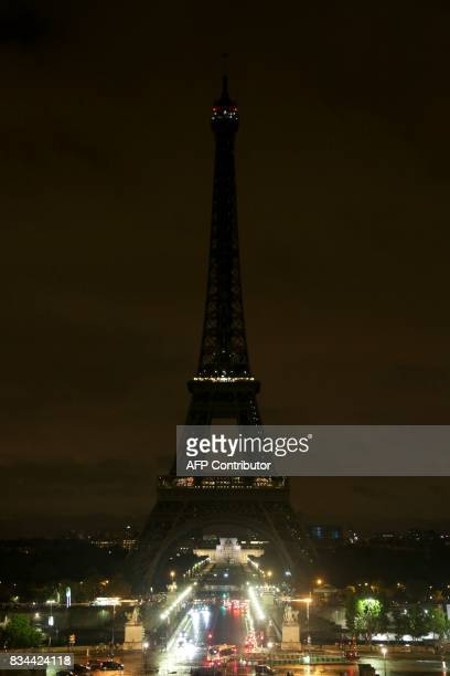 The lights of the Eiffel Tower in the French capital Paris are switched off on August 17 in solidarity with neighbouring Spain following two...