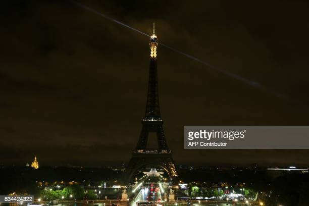 The lights of the Eiffel Tower in the French capital Paris are switched off on August 17 in solidarity with Spain following two quicksuccession...