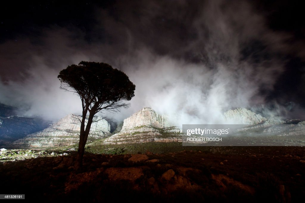 The lights shine on Table Mountain just before being turned off for the global Earth Hour intitiative on March 29 in Cape Town Lights went off in...