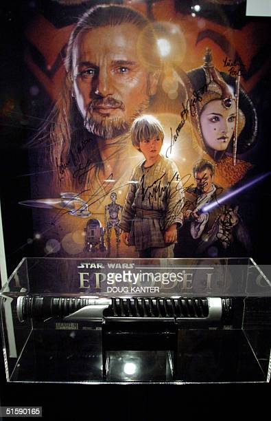 The lightsaber used by Liam Neeson in the movie 'Star WarsThe Phantom Menace' is seen at Sotheby's in New York 02 March 2001 Liam Neeson organized...