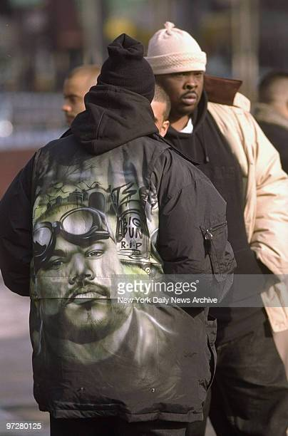 The likeness of rapper Big Pun graces the jacket of a fan outside the Ortiz Funeral Home on Westchester Ave Fans gathered to bid farewell to the...