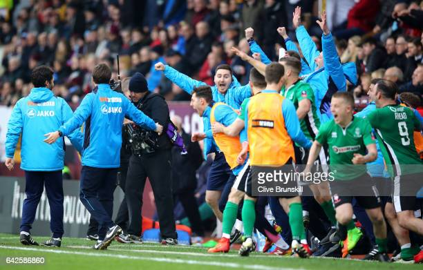 The Lincoln City bench celebrate the final whistle during The Emirates FA Cup Fifth Round match between Burnley and Lincoln City at Turf Moor on...