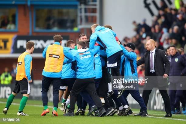 The Lincoln City player and staff celebrate their win after The Emirates FA Cup Fifth Round match between Burnley and Lincoln City at Turf Moor on...