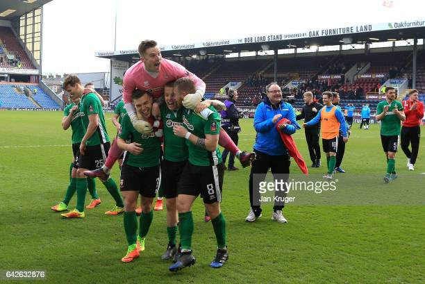 The Lincoln City team celebrate on the ptich after The Emirates FA Cup Fifth Round match between Burnley and Lincoln City at Turf Moor on February 18...