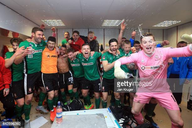 The Lincoln City team celebrate their win in the changing room after The Emirates FA Cup Fifth Round match between Burnley and Lincoln City at Turf...