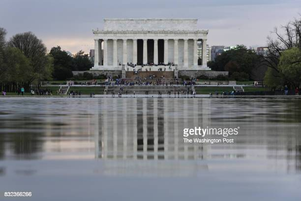 The Lincoln Memorial is reflected in the reflecting pool in the Washington DC on April 6 2017
