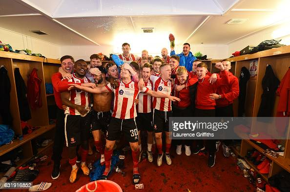 The Lincoln team and staff celebrate their victory in the changing room after the Emirates FA Cup third round replay between Lincoln City and Ipswich...