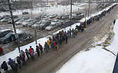 The line at North Quincy was the length of parking lot and took some up to two hour wait for bus The MBTA rails had commuters traveling into Boston...