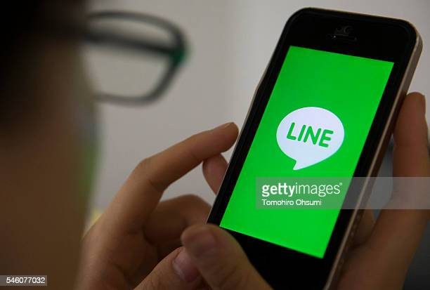 The Line Corp logo is displayed on a smartphone in this arranged photograph on July 11 2016 in Tokyo Japan Japanese messaging app provider LINE Corp...