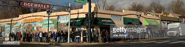 The line stretches around the block at Bud Med to open in Edgewater on the first day of legal recreational marijuana sales in Denver Colorado January...