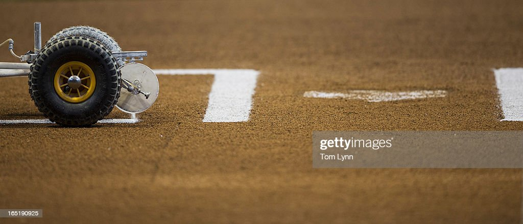 The lines are painted on the field before the start of the game between the Milwaukee Brewers and Colorado Rockies on opening day at Miller Park on April 1, 2013 in Milwaukee, Wisconsin.