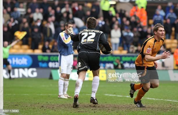 The linesman raises his flag while Wolverhampton Wanderers' Sam Vokes runs away to celebrate as Cardiff City goalkeeper Dimitrios Konstantopoulos...
