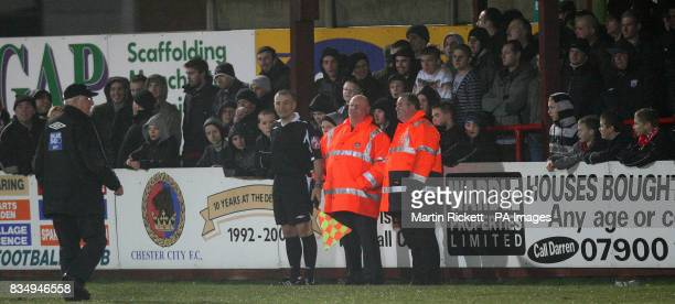 The linesman recieves extra security after getting abuse from fans during the FA Cup Second Round Replay at Butchers Arms Ground Droylsden