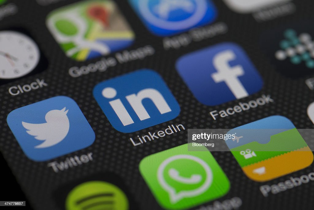 The LinkedIn Corp application icon is displayed along with other apps on an Apple Inc iPhone 5s in an arranged photograph in Hong Kong China on...