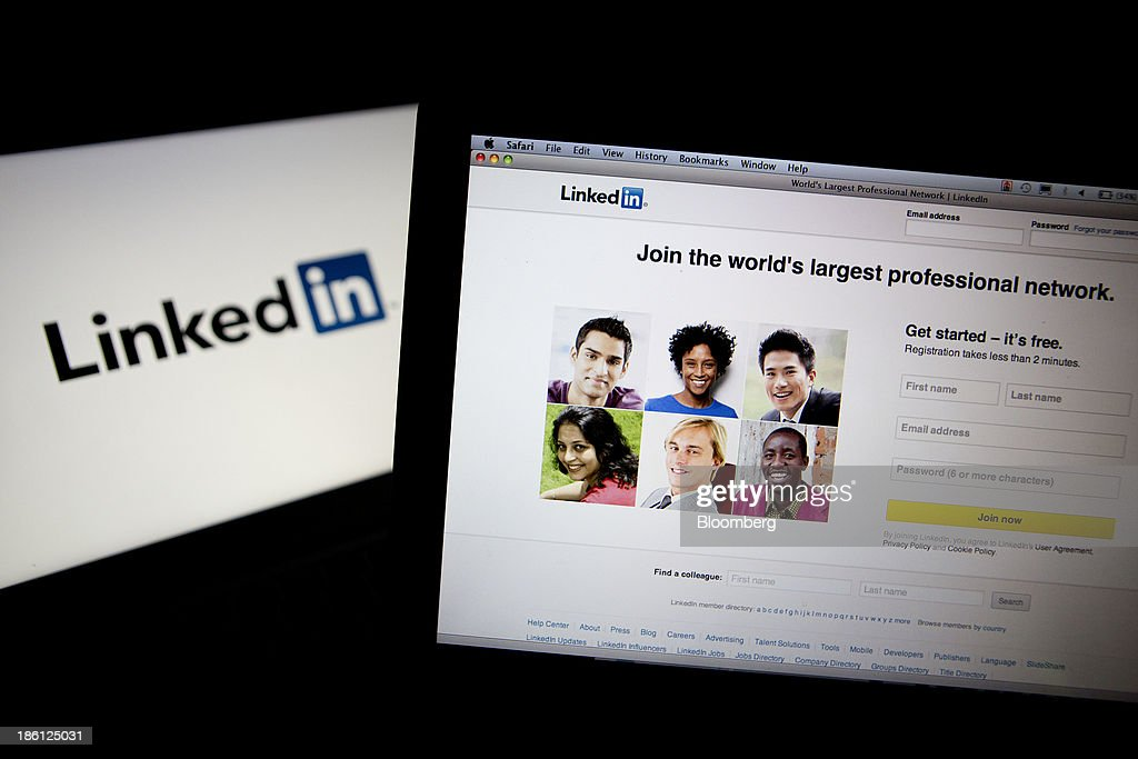 The LinkedIn Corp. homepage and logo are displayed on laptop computers arranged for a photograph in Washington, D.C., U.S., on Monday, Oct. 28, 2013. LinkedIn Corp. is expected to release earnings figures on Oct. 29. Photographer: Andrew Harrer/Bloomberg via Getty Images