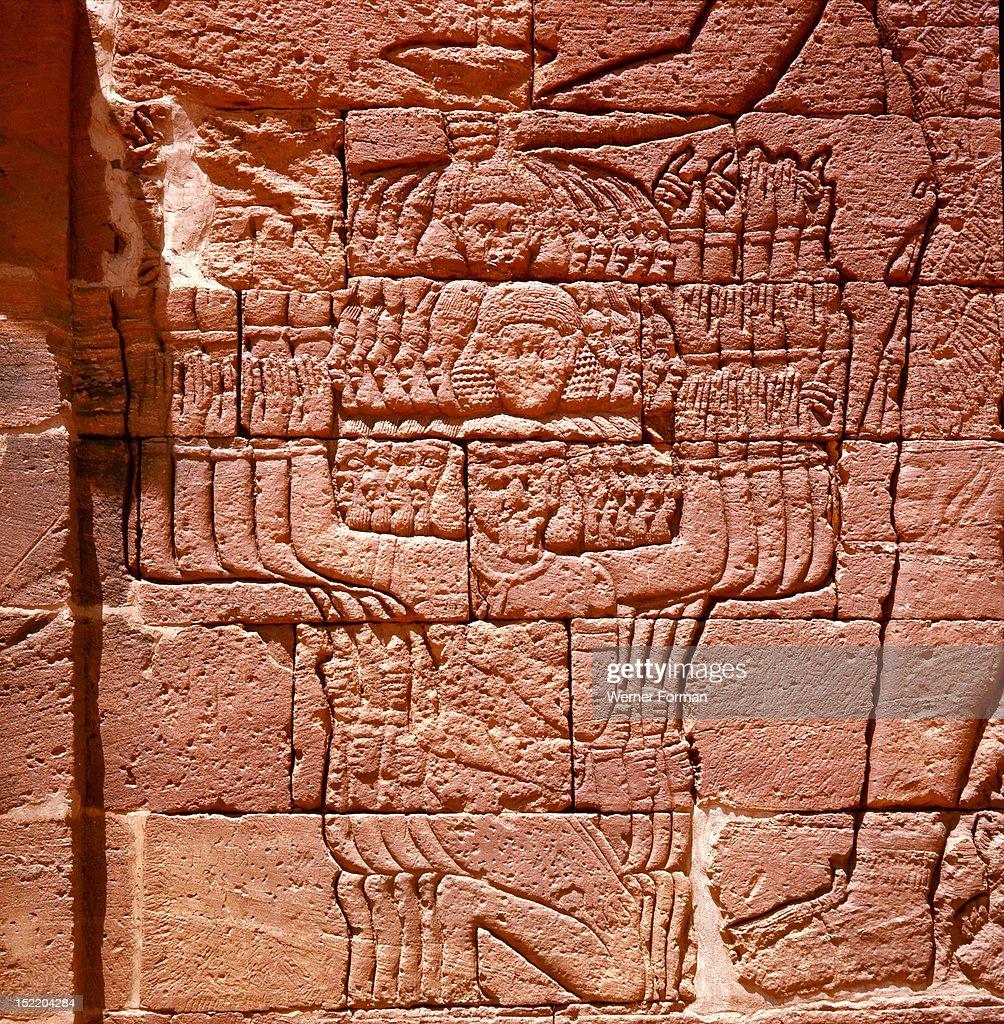 The Lion temple at Naga, Detail of a relief of Queen Amanitare, preparing to smite bound enemies. Sudan. Nubian. c 300 BC 100 BC. Naga, Meroe.