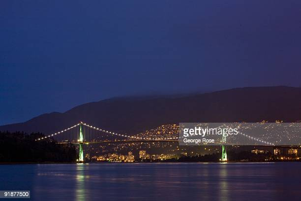 The Lions Gate Bridge is reflected in the harbor as seen in this 2009 Vancouver British Columbia Canada early evening cityscape photo This West Coast...