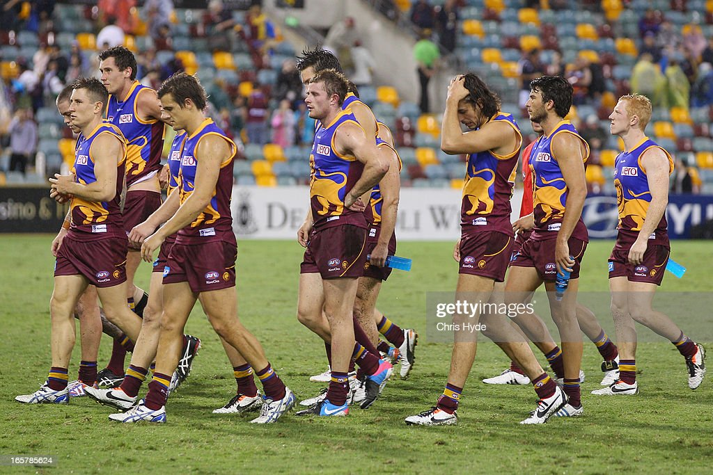 The Lions leave the field after losing the round two AFL match between the Brisbane Lions and the Adelaide Crows at The Gabba on April 6, 2013 in Brisbane, Australia.
