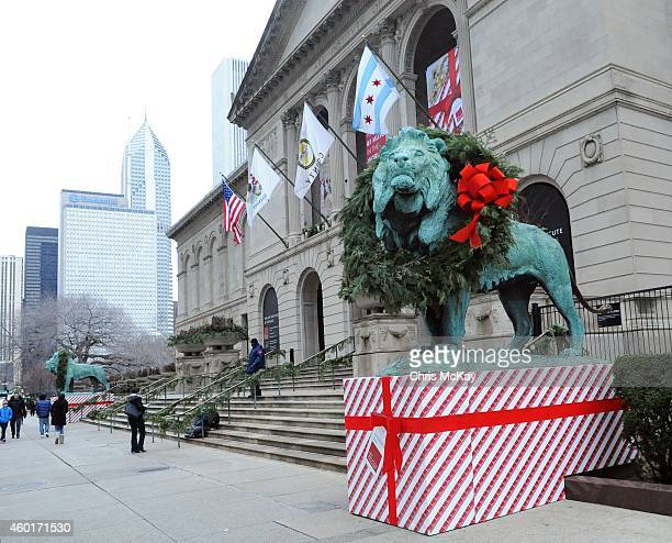 The lions of the Art Institute Of Chicago are decorated for the Christmas season on December 08 2014 in Chicago Illinois