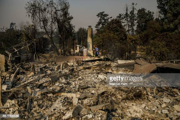 The Lipscomb family Julian from left Rachel and Colette mom survey the damage to their home after it was destroyed in a brush fire on December 6 2017...