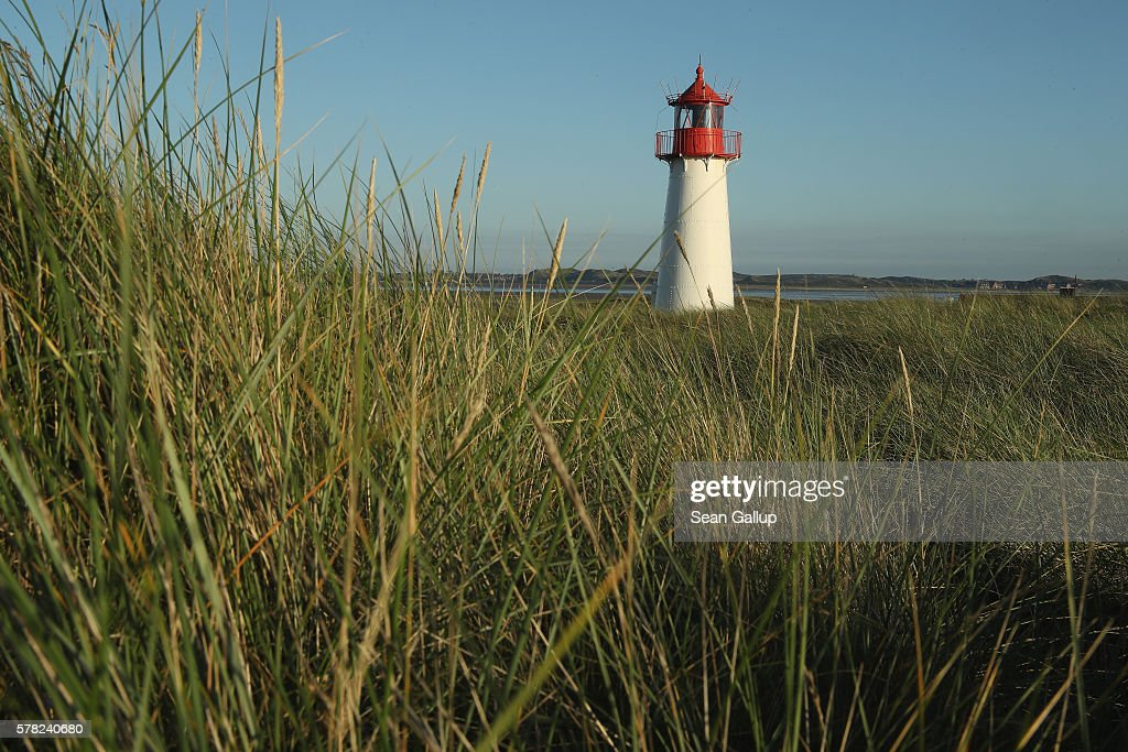 The List West lighthouse stands on the northern end of Sylt Island on July 19, 2016 near List, Germany. Sylt Island, with its long stretches of sand beaches and its protected dune landscapes, is among the most popular holiday destinations, especially for wealthy visitors, along Germany's North Sea coast. Many Germans, unsettled by the recent terror attacks in countries like France and Turkey, are choosing to vacation in Germany this summer.