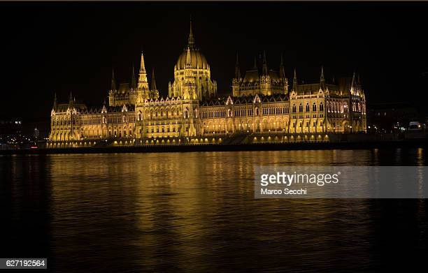 The lit House of Parliament is seen over the Danube from the Buda side on December 2 2016 in Budapest Hungary The traditional Christmas market and...