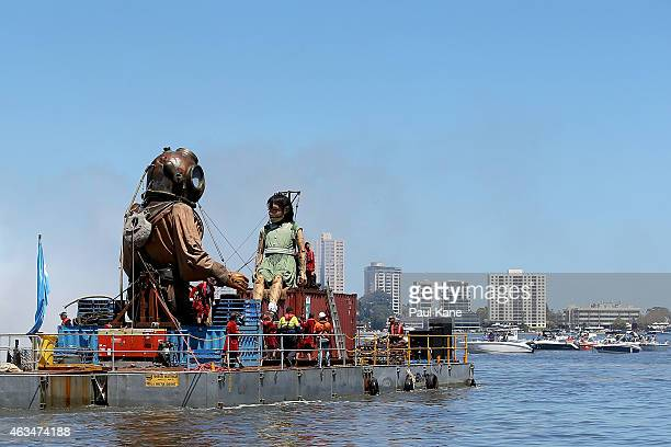 The Little Girl and Diver Giant sit on a barge as the cruise up the Swan River during the Perth International Arts Festival on February 15 2015 in...