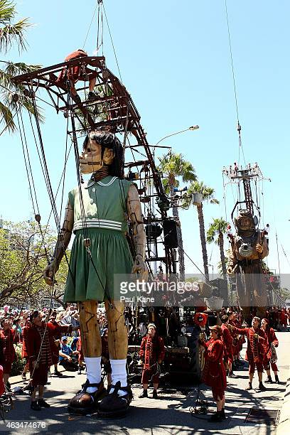 The Little Girl and Diver Giant walk down Riverside Drive during the Perth International Arts Festival on February 15 2015 in Perth Australia