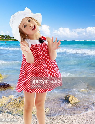 The little girl claps : Stock Photo