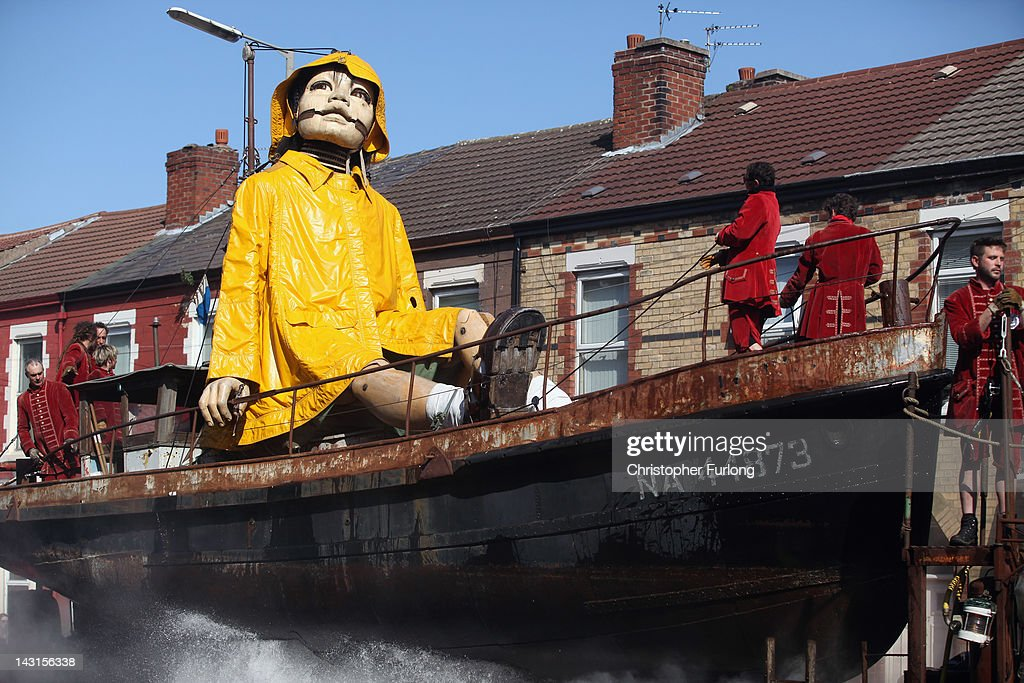 The Little Girl Giant Marionette makes it's way through the streets of Liverpool as the Titanic Sea Odyssey giant puppet spectacular gets underway on April 20, 2012 in Liverpool, England. Over the next three days French street theatre company Royal De Luxe will be performing Sea Odyssey with the giants coming to life telling a story inspired by The Titanic.