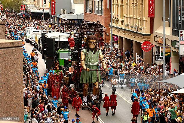 The little girl Giant rides her scooter down Hay Street during the Perth International Arts Festival on February 13 2015 in Perth Australia