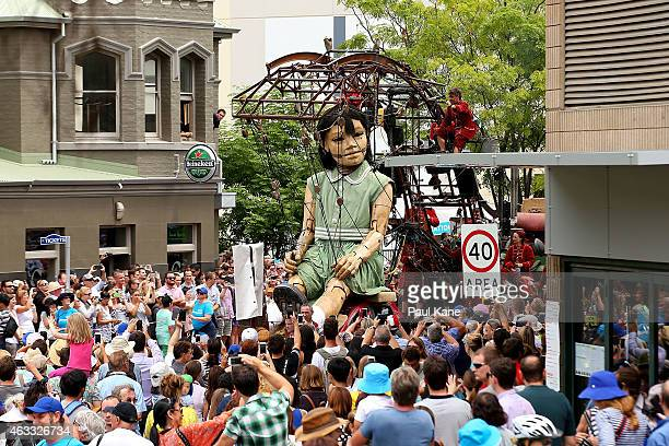 The little girl Giant sits on a vehicle while travelling down Hay Street during the Perth International Arts Festival on February 13 2015 in Perth...