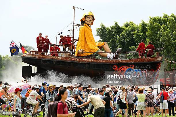 The little girl Giant sits on top of a boat while travelling down Plain Street during the Perth International Arts Festival on February 13 2015 in...